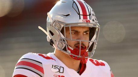 Jeremy Ruckert of the Ohio State Buckeyes warms