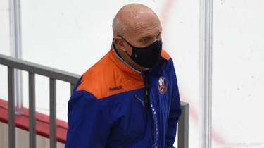 Islanders general manager Lou Lamoriello enters the arena