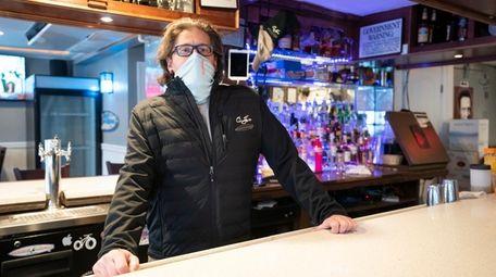 Rob Weber behind the bar at CJ's Restaurant