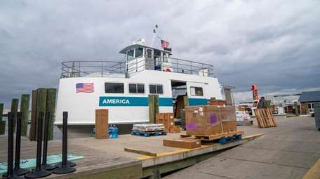 A ferry drops off cargo on the dock