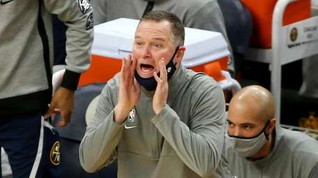 Denver Nuggets head coach Mike Malone yells in