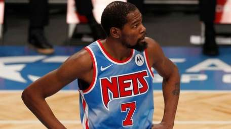 Kevin Durant #7 of the Nets looks on