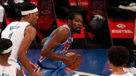 Kevin Durant #7 of the Nets drives to
