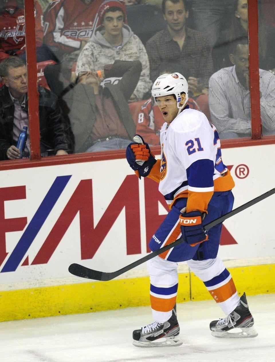 Islanders right wing Kyle Okposo celebrates his goal