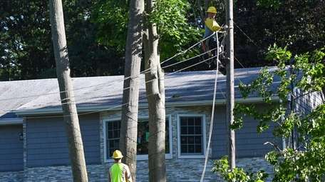 PSEG employees work to restore power in Lake
