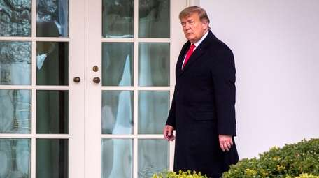 President Donald Trump walks to the Oval Office