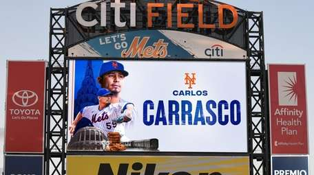 Carlos Carrasco on the Mets scoreboard on Jan.