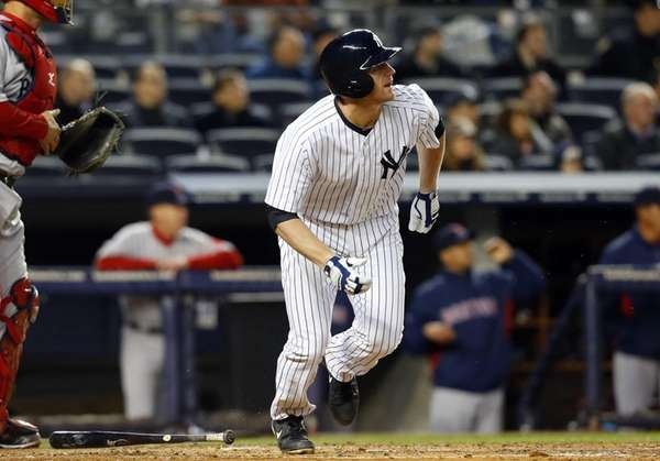 Lyle Overbay of the Yankees follows through on