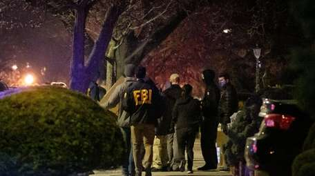 Police conduct an investigation on 76th Street near