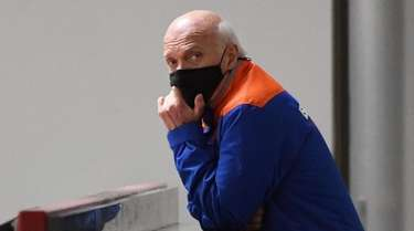 Islanders general manager Lou Lamoriello observes practice during