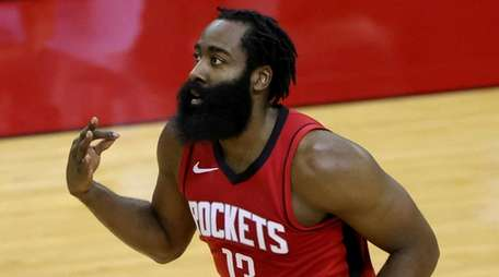 James Harden of the Rockets reacts to a