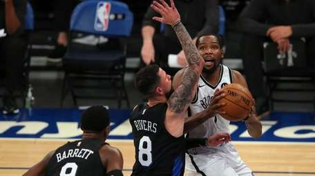 Nets forward Kevin Durant drives to the basket