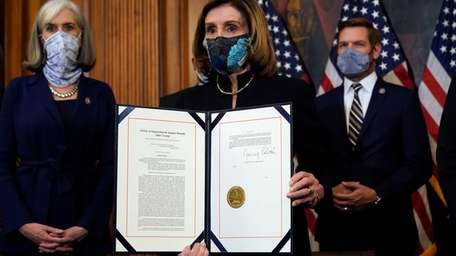 Speaker Nancy Pelosi with the document she signed