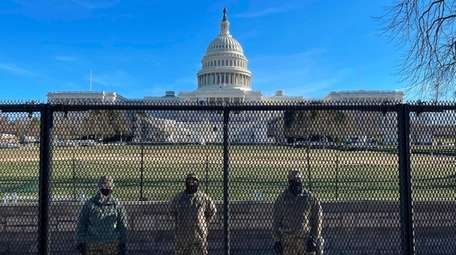National Guard soldiers guard the grounds of the