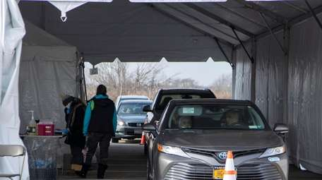 The state's first drive-thru COVID-19 vaccination center opens