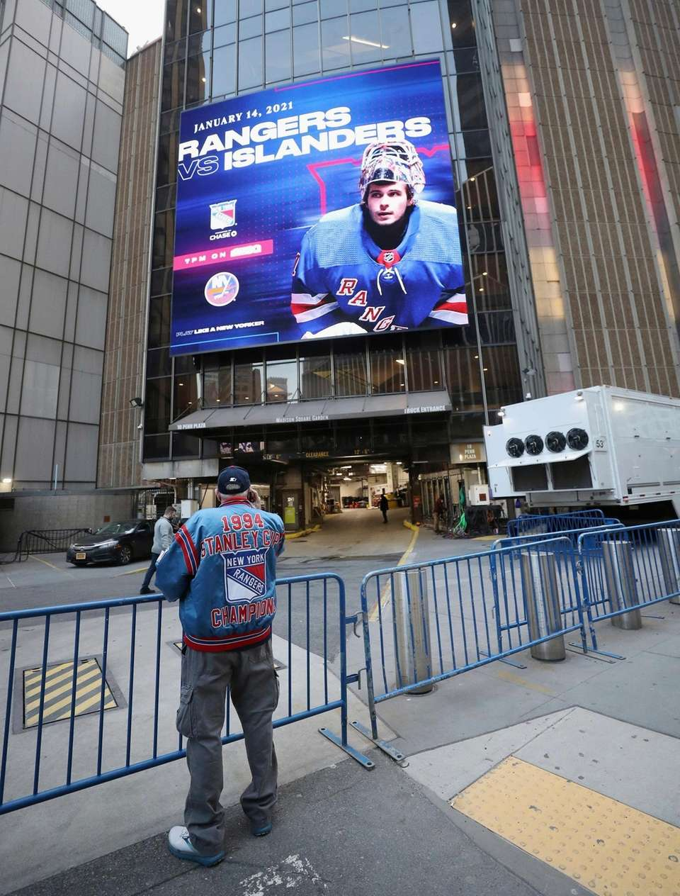 A fan watches players arrive at Madison Square