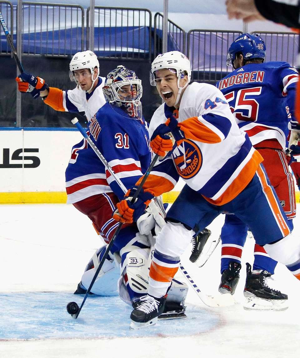 New York Islanders' Jean-Gabriel Pageau, right, celebrates a