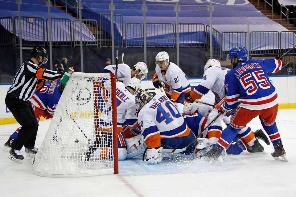 The Islanders and Rangers scramble in front of