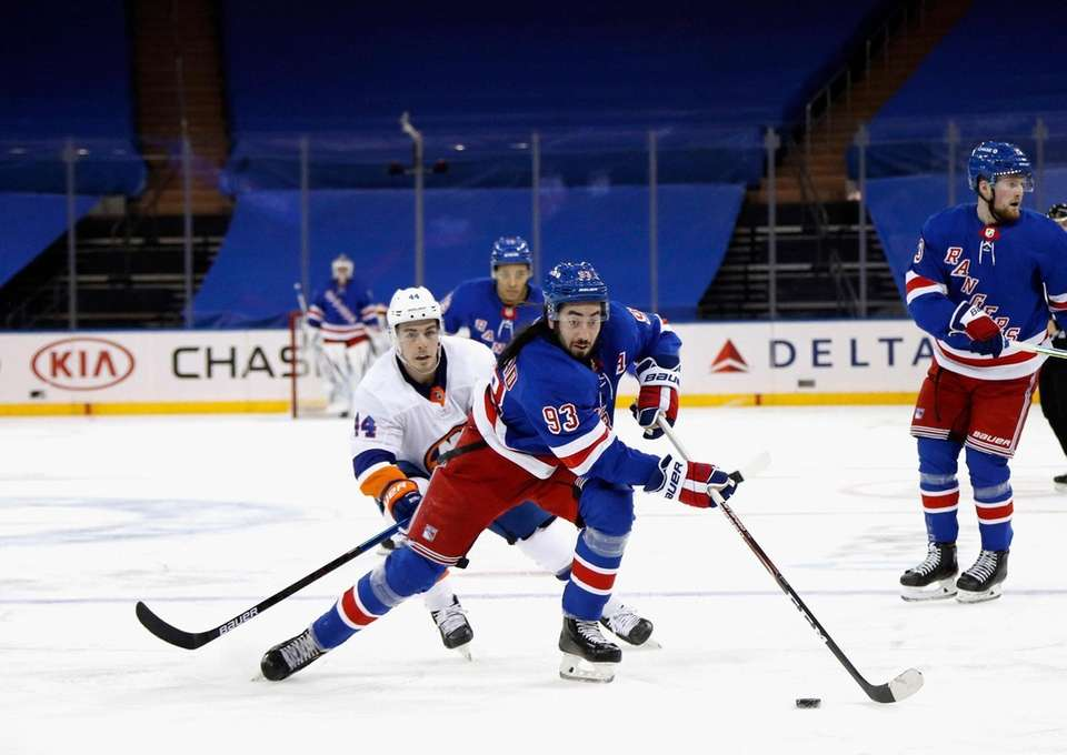 The Rangers' Mika Zibanejad carries the puck during