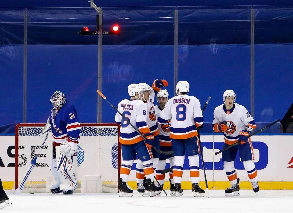 The Islanders celebrate a power-play goal by Anders