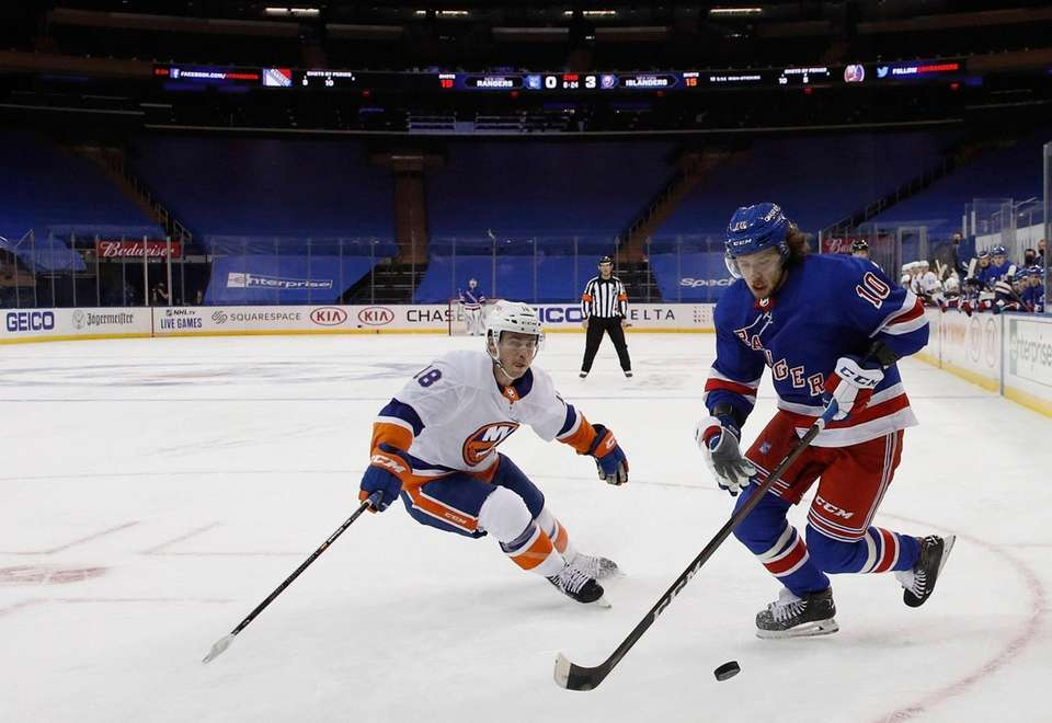 The Rangers' Artemi Panarin, right, carries the puck