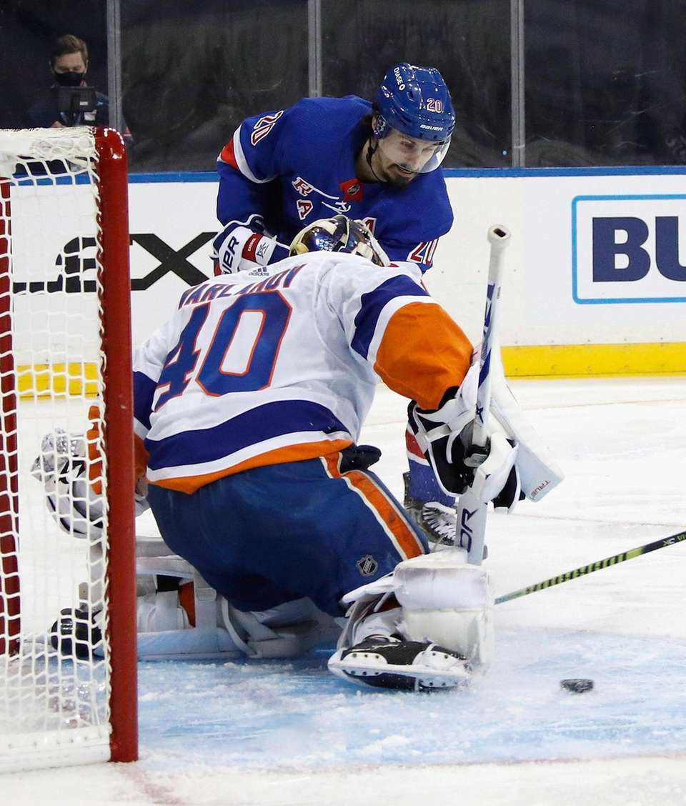 The Islanders' Chris Kreider misses the net as