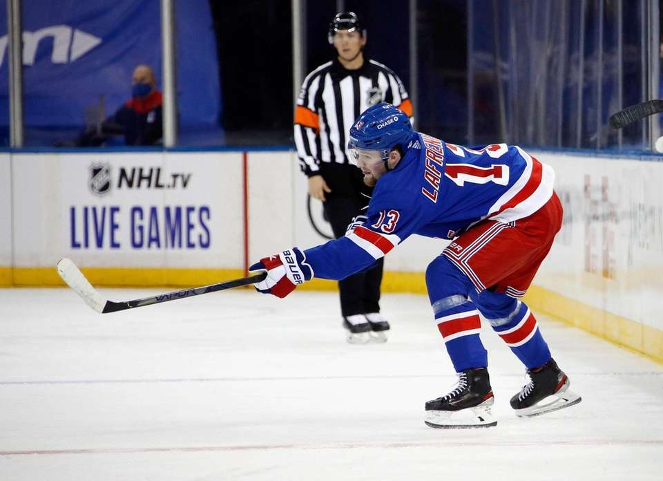 The Rangers' Alexis Lafreniere skates in his first