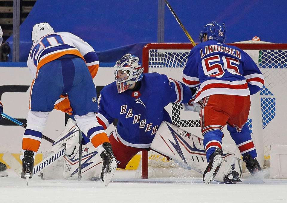 Rangers goalie Igor Shesterkin defends the net against