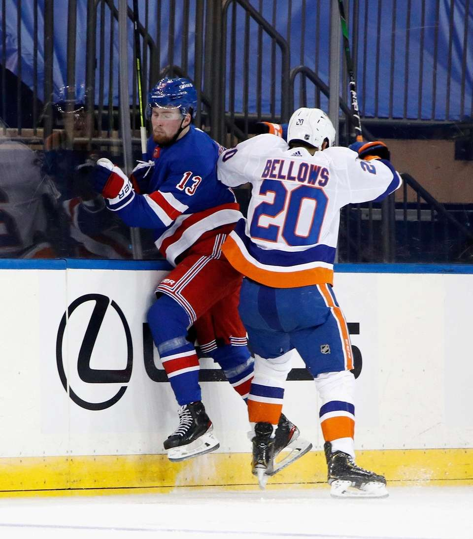 The Rangers' Alexis Lafreniere, left, is checked by