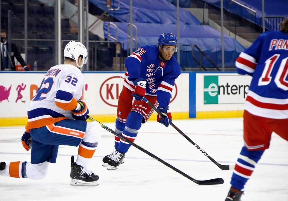 The Rangers' K'Andre Miller skates with the puck