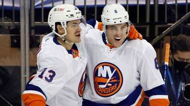 The Islanders' Mathew Barzal, left, celebrates his first-period