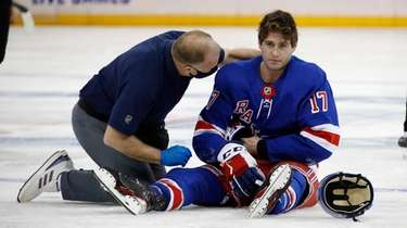 Trainer Jim Ramsay tends to the Rangers' Kevin