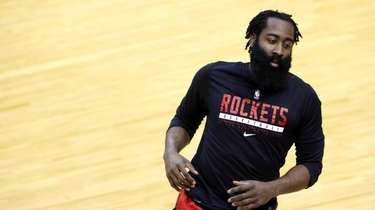 James Harden #13 of the Houston Rockets warms
