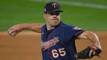 Trevor May of the Twins pitches in the