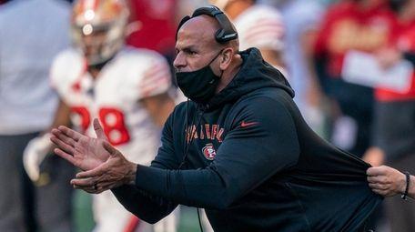 San Francisco 49ers defensive coordinator Robert Saleh cheers