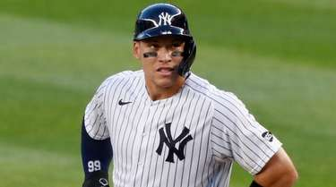 Yankees rightfielder Aaron Judge stands on first after