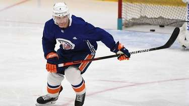 New York Islanders defenseman Andy Greene skates during