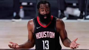 The Rockets' James Harden argues a call during