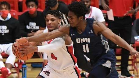 Stony Brook guard Tykei Greene is defended by