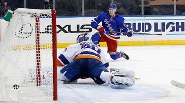 The Rangers' Kaapo Kakko scores against Islanders goalie