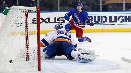 The Rangers' Kaapo Kakko scores against Islanders goalie