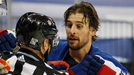 The Rangers' Brendan Smith, right, is pulled out