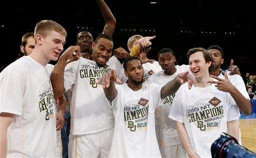 Baylor's Chad Rykhoek, center, poses for photographs with