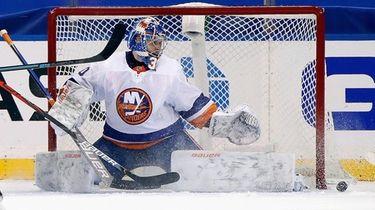 New York Islanders goalie Ilya Sorokin kicks out