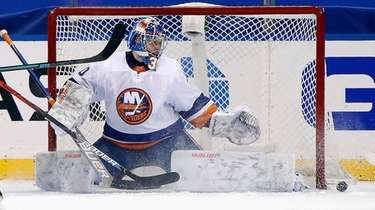 New York Islanders goalie Ilya Sorokin kicks out