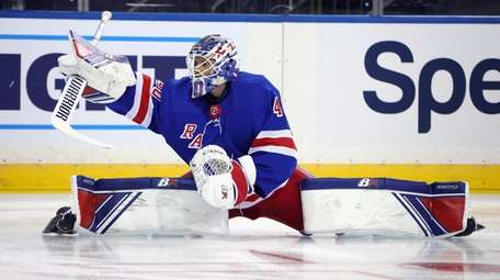 Rangers' Alexandar Georgiev stretches as players warm up