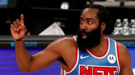 James Harden of the Brooklyn Nets reacts after