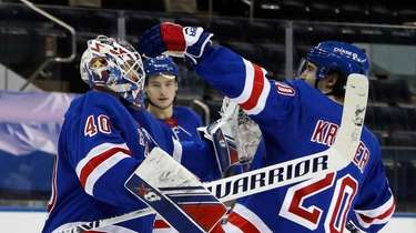 Rangers goalie Alexandar Georgiev, left, and teammates celebrate