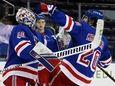 Rangers goalie Alexandar Georgiev, left, and teammates celebrate