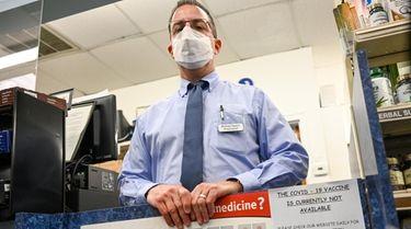 Pharnacist Michael Nastro inside his Fairview Pharmacy and